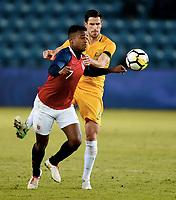 Fotball , 23. mars 2018 , privatkamp , Norge - Australia<br /> Norway - Australia<br /> Milos Degenek  , Australia<br /> Ola Kamara , Norge