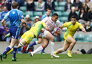 Picture by Andrew Tobin/Tobinators Ltd +44 7710 761829.12/05/2013.Marcus Watson of England is tackled by Ed Jenkins of Australia as England lose 14-7 in the semi final during the Emirates London 7s at Twickenham Stadium, Twickenham.