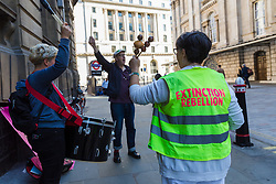 © Licensed to London News Pictures. 13/09/2019. London, UK. Members of Extinction Rebellion play musical instruments outside City of London Magistrates court this morning. Over 50 defendants from across the UK are appearing at City of London Magistrates court in London today, charged with being public assembly participants failing to comply with police conditions related to Extinction Rebellion climate change protests in London. Photo credit: Vickie Flores/LNP