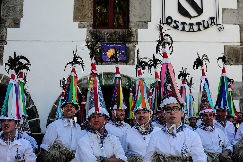 January 29, 2018 - Ituren, navarra, Spain - A group of Joaldunaks called Zanpantzar, take part in the Carnival between the Pyrenees villages of Ituren and Zubieta, northern Spain, Monday, Jan. 29, 2018.The Basque Country's Ituren Carnival is known to be the oldest pagan festival in Europe, and it comes with a dark twist. For many, the idea of a Carnival conjures up images of bright colours, laughter and celebrations. However the Ituren Carnival symbolises the on-going struggle between good and bad, or light and dark. Young men symbolise the 'good' and dress in sheepskins, with cow bells wrapped around their waists. According to legend, the jingle of the bells wards off bad spirits. On their heads, they wear extravagant hats with ribbon details. Meanwhile, the other villagers (women, children and older men) dress as bad spirits and wear eerie masks and dark clothing. (Credit Image: © Mikel Cia Da Riva/Pacific Press via ZUMA Wire)