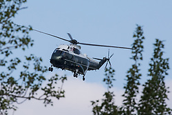 Windsor, UK. 13th June, 2021. One of President Biden's VH-3D Sea King helicopters, known as Marine One, is pictured approaching Windsor Castle. President Biden and First Lady Jill Biden were welcomed at Windsor Castle by the Queen following the G7 summit with a Guard of Honour followed by afternoon tea.