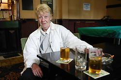 Woman having a drink in a pub,