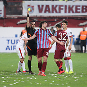 Referee's Ali Palabiyik show the yellow card to Trabzonspor's Salih Dursun during their Turkish SuperLeague Derby match Trabzonspor between Galatasaray at the Avni Aker Stadium at Trabzon Turkey on Sunday, 19 April 2015. Photo by TVPN/TURKPIX