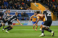Mansfield Town midfielder Alex MacDonald (7) shoots during the EFL Sky Bet League 2 match between Mansfield Town and Grimsby Town FC at the One Call Stadium, Mansfield, England on 4 January 2020.