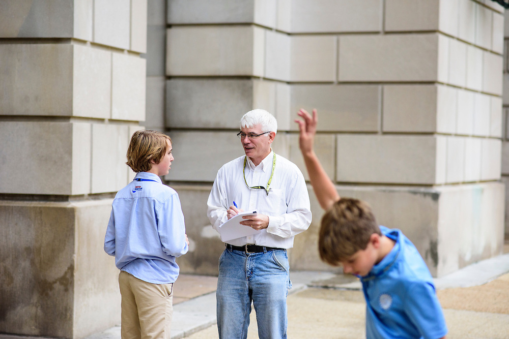 Washington, D.C. - October 07, 2016: Dan Vergano, science reporter with Buzzfeed, interviews Roger Brown outside the Environmental Protection Agency building after The Hyperbolics met with EPA officials. Fellow Hyperbolic Doug Landrum flies past in the foreground.<br /> <br /> The Hyperbolics are a First Lego League team based out of Sterling School in Greenville SC, who made a trip to DC ask government officials to ban lead wheel weights Friday October 7, 2016.<br /> <br /> <br /> CREDIT: Matt Roth for Earthjustice