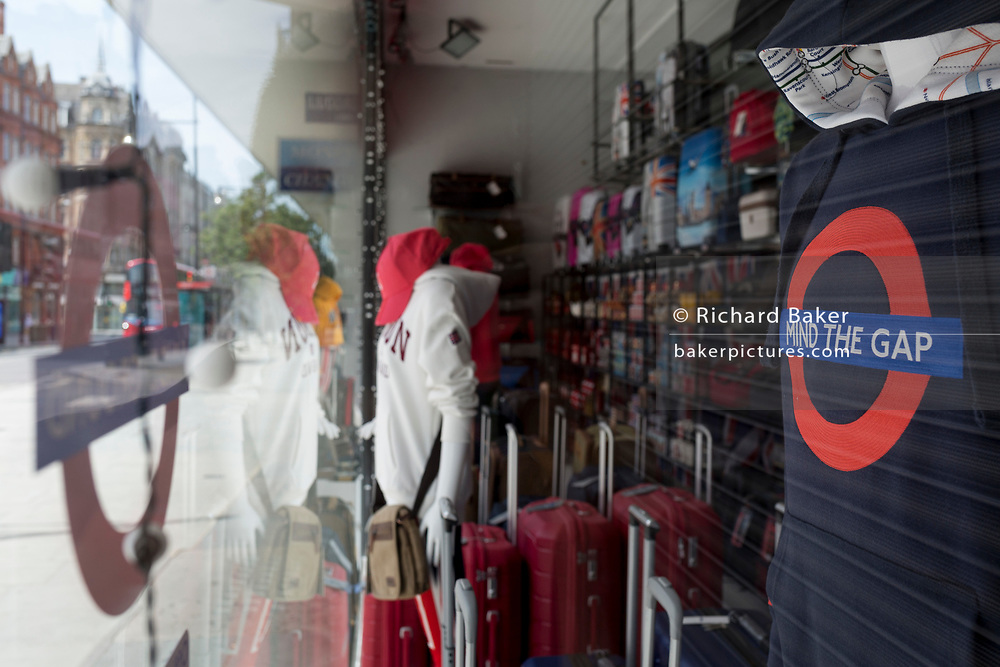 During the UK's Coronavirus pandemic lockdown and on the day when a further 255 deaths occurred, bringing the official covid deaths to 37,048, <br /> it is expected that many shops and retail businesses will open again on 15th June, a tourist trinket shop on Oxford Street reminds customers to Mind the Gap, a pun on the gaps on the underground transport system platforms as well as social distance 2m rule, on 26th May 2020, in London, England.