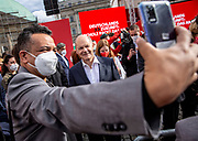 SPD Chancellor candidate and current German Finance Minister Olaf Scholz poses for a selfie with a supporter, following an election campaign event of the German Social Democratic Party (SPD) at Bebelplatz square In Berlin, Germany, August 27, 2021. Germany's federal elections are due to take place on September 26, 2021.