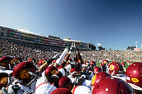 1 January 2007: Players  huddle and raise their hands for number one at the 93rd Rose Bowl Game at the Rose Bowl Stadium for the Pac-10 USC Trojans vs the Big-10 Michigan Wolverines NCAA college football game in Southern California.  Trojans defeated the Wolverines 32-18 in regulation.<br />