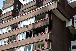 London, UK. 4th May, 2018. The flat on the fourth floor of a block in Windlass Place, Surrey Quays, where a fire broke out. London Fire Brigade's press liaison officer advised that a total of eight pumps were called out to the fire and that no one was present in the flat at the time of the fire.