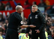 Referee Mike Dean talks to Ole Gunnar Solskjaer manager of Manchester United during the Premier League match at Old Trafford, Manchester. Picture date: 8th March 2020. Picture credit should read: Darren Staples/Sportimage