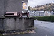 Armchair soft furniture left outside Welsh town flats, on 3rd October 2021, in Blaenau Ffestiniog, Gwynedd, Wales.