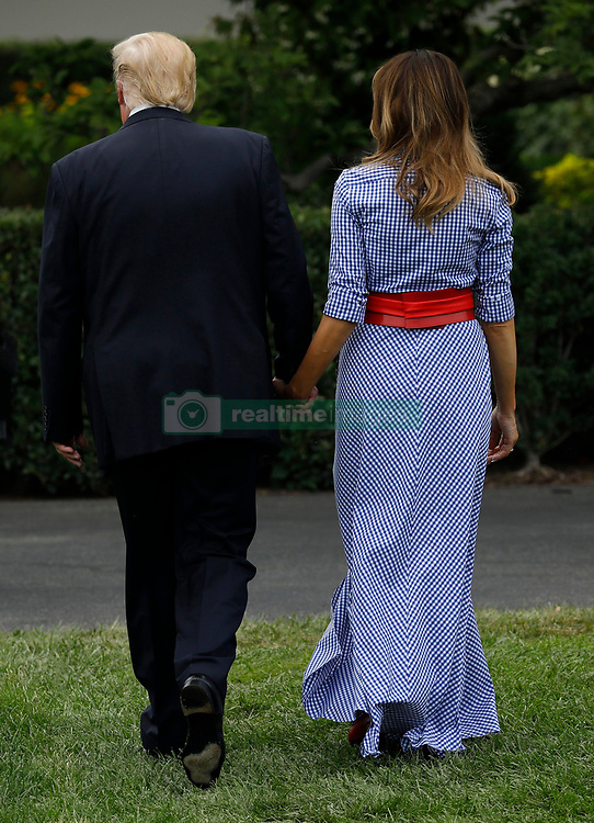 U.S. President Donald Trump and First Lady Melania Trump greet guests at a picnic for military families in Washington, D.C., U.S., on Wednesday, July 4, 2018. Dozens of retired military and national security officers joined the NAACP and the American Medical Association in urging a federal appeals court to uphold a court order blocking Trump's ban on transgender people serving in the military. 04 Jul 2018 Pictured: U.S. President Donald Trump and First Lady Melania Trump leave after attending a picnic for military families in Washington, D.C., U.S., on Wednesday, July 4, 2018. Dozens of retired military and national security officers joined the NAACP and the American Medical Association in urging a federal appeals court to uphold a court order blocking Trump's ban on transgender people serving in the military. Credit: Yuri Gripas / Pool via CNP. Photo credit: Yuri Gripas - Pool via CNP / MEGA TheMegaAgency.com +1 888 505 6342