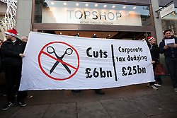 © Licensed to London News Pictures. 17/12/2011. LONDON, UK. UK Uncut protesters hold a banner outside Topshop's flagship store on Oxford Street in London today (17/12/11). The demonstrators had intended to hold a protest inside the shop, but the few that gained entry were ejected by security and police. Photo credit: Matt Cetti-Roberts/LNP