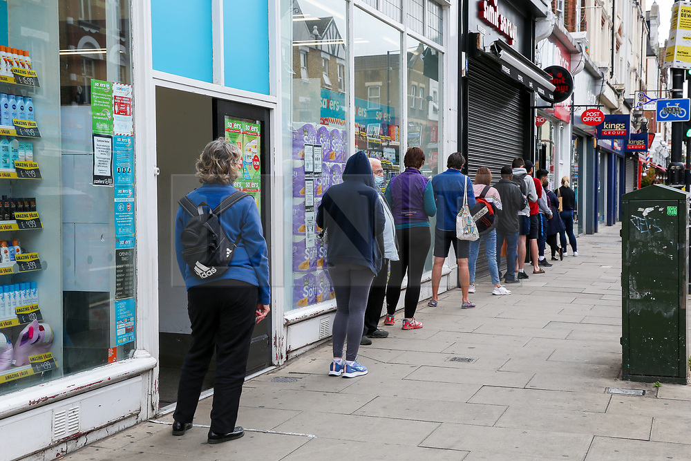 © Licensed to London News Pictures. 30/06/2020. London, UK. Shoppers queue outside a post office on Green Lanes, Harringay. The London Borough of Haringey is amongst 36 areas in England where COVID-19 cases are rising according to Public Health England. Photo credit: Dinendra Haria/LNP