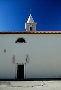 Wall, door, arch and tower. Nin, Croatia