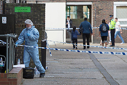 © licensed to London News Pictures. London, UK 13/08/2013. Forensic officers investigating Spey Street in Poplar, east London where 16-year-old Ajmol Alom was found stabbed. Photo credit: Tolga Akmen/LNP