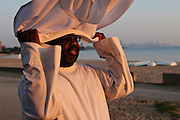 Pastor Tom Jackson O.P. of Holy Name of Mary prepares to celebrate a sunrise mass at Rainbow Beach on the city's south side to pray for peace and non-violence during the upcoming school year. The event hosted by The Black Catholic Deacons in the Archdiocese of Chicago is one of six simultaneous masses along Chicago's lakefront. August 25, 2012 Brian J. Morowczynski/ViaPhotos.
