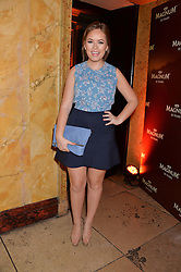 TANYA BURR at a party to celebrate 25 years of the Magnum ice ream held at home House, 20 Portman Square, London on 26th March 2014.