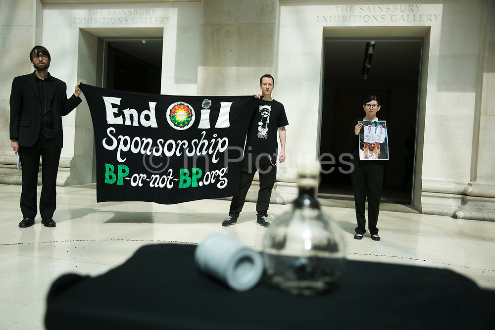 """The art activist protest group Bp-or-not-Bp make an artistic intervention at the British Museum to highlight the fact that the oil company BP sponsors a show called Sunken Cities at the Museum May 17 2016. (photo by Kristian Buus/In Pictures via Getty Images) A bottle with crude oil from the oil dissaster in the Guld of Mexico, caused by BP and a tear gas canister used in Egypt is on display surrounded by the many small black stones. The press release states:  """"The lines of stones in the artwork represent the 340 people forcibly disappeared in the four months prior to BP signing a $12bn dollar deal with the Sisi regime – a rehash of a deal it had made with the Mubarak regime. The total number disappeared under the Sisi regime may run into thousands. Teargas is a weapon that was used both to repress popular protest in Tahrir Square during the revolution but also those who actively opposed BP's operations in the country. """""""