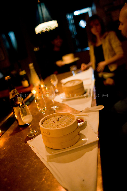 9 October, 2008. New York, NY. Steamers containing dumplings are here on the bar at Shorty's 32 Restaurant in Soho. Shorty's 32 has late night services some nights. <br /> <br /> ©2008 Gianni Cipriano for The New York Times<br /> cell. +1 646 465 2168 (USA)<br /> cell. +1 328 567 7923 (Italy)<br /> gianni@giannicipriano.com<br /> www.giannicipriano.com