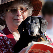 Dot Hodder sings gyms with a friend's dog Sebastian during the St. Frances Day Blessing of the Animals Sunday October 5, 2014 at Hugh McRae Park in Wilmington, N.C. The event was sponsored by Good Shepherd Church. (Jason A. Frizzelle)