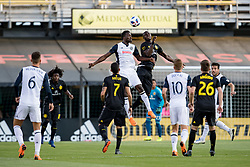 May 9, 2018 - Columbus, OH, U.S. - COLUMBUS, OH - MAY 09: Philadelphia Union forward C.J. Sapong (17) heads the ball as Columbus Crew defender Jonathan Mensah (4) defends in the MLS regular season game between the Columbus Crew SC and the Philadelphia Union on May 09, 2018 at Mapfre Stadium in Columbus, OH. (Photo by Adam Lacy/Icon Sportswire) (Credit Image: © Adam Lacy/Icon SMI via ZUMA Press)