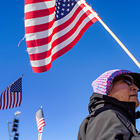 112614       Cable Hoover<br /> <br /> Susie Wauneka carries a flag as she marches with the Navajo Voter's Rights Coalition during a protest in Window Rock Wednesday.