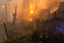 March 23, 2019 - DHAKA, BANGLADESH - MARCH 22 : Firefighters try to control a fire which broke out at a paper warehouse at Lalbagh in Old Dhaka, Bangladesh on March 22, 2019..In recent at least 70 people were killed on February 20, 2019 when a massive fire spread through several apartment buildings in Bangladesh's capital. (Credit Image: © Zakir Hossain Chowdhury/ZUMA Wire)