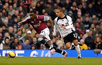 Photo: Alan Crowhurst.<br />Fulham v West Ham United. The Barclays Premiership. 23/12/2006. Nigel Reo-Coker of West Ham (L) takes on Wayne Routledge.