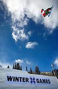 SHOT 1/25/08 12:48:35 PM - Lonnie Kauk of Mammoth Lakes, Ca. catches big air between a gap jump during practice for Snowboard Slopestyle qualifying Friday January 25, 2008 at Winter X Games Twelve in Aspen, Co. at Buttermilk Mountain. The 12th annual winter action sports competition features athletes from across the globe competing for medals and prize money is skiing, snowboarding and snowmobile. Numerous events were broadcast live and seen in more than 120 countries. The event will remain in Aspen, Co. through 2010..(Photo by Marc Piscotty / © 2008)