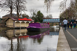 The Union Canal with narrowboat and Edinburgh Canal Society boathouse in early spring  in Edinburgh, Scotland, UK