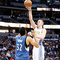 15 February 2017: Denver Nuggets center Mason Plumlee (24) takes a jump shot over Minnesota Timberwolves center Karl-Anthony Towns (32) during the Minnesota Timberwolves 112-99 victory over the Denver Nuggets, at the Pepsi Center, Denver, Colorado, USA.