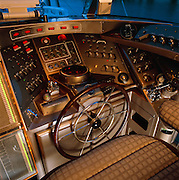 The steering station in the pilot house of the starship Andromeda, a schooner that has the same control switches used in nuclear power plants.