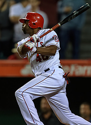 NAHEIM, California/USA (Tuesday, September 26, 2012) - Los Angeles Angels outfielder Torii Hunter gets his 10th career walk-off hit, an RBI single that gave the Angels a 4-3 victory during the Angels vs. Mariners game held at the Angels Stadium. Byline and/or web usage link must read PHOTO © Eduardo E. Silva/SILVEX.PHOTOSHELTER.COM.