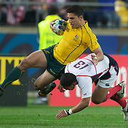 Anthony Fainga'a, Australia, is tackled by Tai Enosa, USA, during the Australia V USA, Pool C match during the IRB Rugby World Cup tournament. Wellington Stadium, Wellington, New Zealand, 23rd September 2011. Photo Tim Clayton...