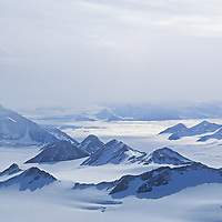 Ice fog and haze hang over the Amundsen Glacier and Queen Maud Mountains in Antarctica.