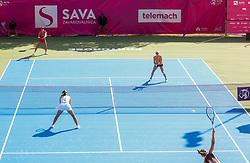 PORTOROZ, SLOVENIA - SEPTEMBER 13:Andreja Klepac of Slovenia (red) and Tamara Zidansek of Slovenia (orange) playing doubles against Kaja Juvan of Slovenia and Natela Dzalamidze of Russia (white) during the 1st Round of WTA 250 Zavarovalnica Sava Portoroz at SRC Marina, on September 13, 2021 in Portoroz / Portorose, Slovenia. Photo by Vid Ponikvar / Sportida