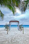 A beach wedding archway on a tropical resort.