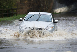 © London News Pictures. 29/04/2012. Ingatestone, UK. A car driving through flood water on a road near the town of Ingateston in Essex on April 29, 2012 . The nearby river Wid broke it's banks following torrential rainfall. Photo credit : Ben Cawthra /LNP