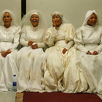 18 couples of Jewish immigrants from India, member of the 'Bnei Menashe' community, get married in a shared wedding ceremony at the The Great Synagogue in Jerusalem, March 02, 2008. For the last 50 years Bnei Hamenashe seek their roots in Judaism as one of the lost tribes of Israel. Today 7000 Bnei Hamenashe in the States of Manipur and Mizoram in North India live full Jewish lives. Those who immigrate to Israel undergo Orthodox conversion in the framework of which they have to remarry according to Jewish Law...Photo by Michal Fattal..... *** Local Caption *** ..
