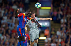 LONDON, ENGLAND - Monday, August 20, 2018: Liverpool's James Milner (right) and  Crystal Palace's Mamadou Sakho (left) challenge for a header during the FA Premier League match between Crystal Palace and Liverpool FC at Selhurst Park. (Pic by David Rawcliffe/Propaganda)