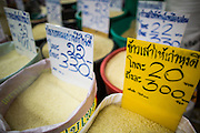 "03 OCTOBER 2012 - BANGKOK, THAILAND:     Grades and varieties of rice for sale in Khlong Toey Market. Khlong Toey (also called Khlong Toei) Market is one of the largest ""wet markets"" in Thailand. Thousands of people shop in the sprawling market for fresh fruits and vegetables as well meat, fish and poultry every day.     PHOTO BY JACK KURTZ"