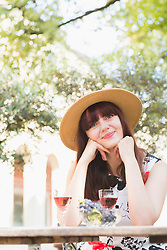 Beautiful woman sitting at outdoor restaurant
