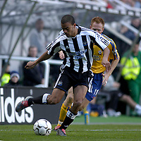 Photo. Glyn Thomas.<br /> Newcastle v Southampton. FA Barclayard Premiership.<br /> St James' Park, Newcastle. 04/10/03.<br /> Newcastle's Kieron Dyer, who got some stick from the crowd, is pursued by Michael Svensson.