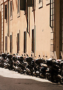 Mopeds parked on the street, Rome, Italy.