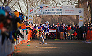 SHOT 1/12/14 4:45:38 PM - Jonathan Page (#1) of Northfield, N.H.  high fives fans as he makes his way towards the finish line in the Men's Elite race at the 2014 USA Cycling Cyclo-Cross National Championships at Valmont Bike Park in Boulder, Co. Page finished sixth in the race. (Photo by Marc Piscotty / © 2014)
