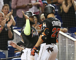 September 2, 2017 - Miami, FL, USA - The Miami Marlins' Marcell Ozuna greets teammate Giancarlo Stanton (27) after his solo home run in the first inning against the Philadelphia Phillies at Marlins Park in Miami on Saturday, Sept. 2, 2017. (Credit Image: © Pedro Portal/TNS via ZUMA Wire)