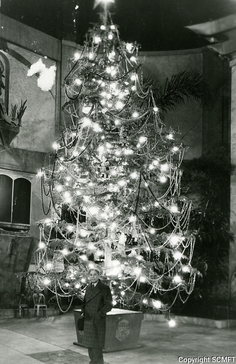 1935? Sid Grauman stands in front of a Christmas tree in the forecourt of his Chinese Theater