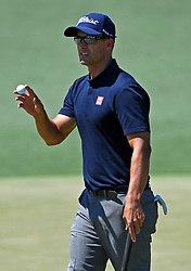 Adam Scott acknowledges the applause of the gallery following a putt on the 2nd green during the third round of the Masters Tournament at Augusta National Golf Club in Augusta, Ga., on Saturday, April 8, 2017. (Photo by Jeff Siner/Charlotte Observer/TNS) *** Please Use Credit from Credit Field ***