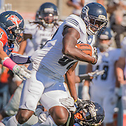 DeAndre McNeal#88 of Fullerton College stiff arm Kyre Adams #31 of Orange Coast College at Lebard Stadium on Saturday November 5